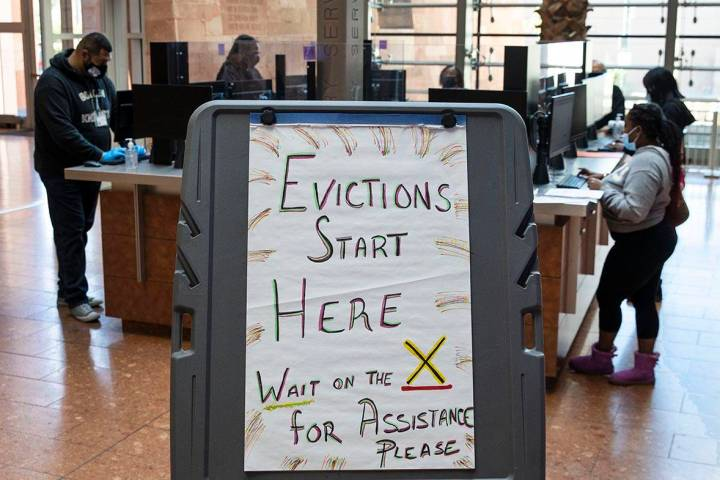 Tenants who received an eviction notice from their landlord fill out forms at the Civil Law Sel ...