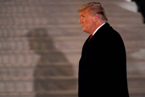 President Donald Trump arrives on the South Lawn of the White House, Tuesday, Jan. 12, 2021, in ...