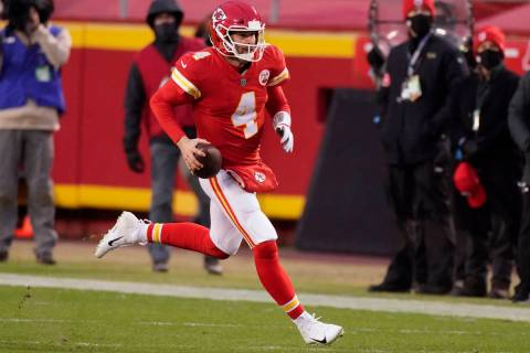 Kansas City Chiefs quarterback Chad Henne scrambles up field during the second half of an NFL d ...