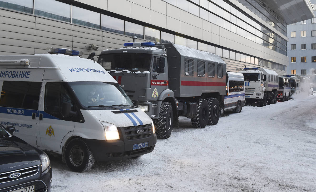 Russian Rosguardia (National Guard) and police buses stand prior to Alexei Navalny's arrival, a ...