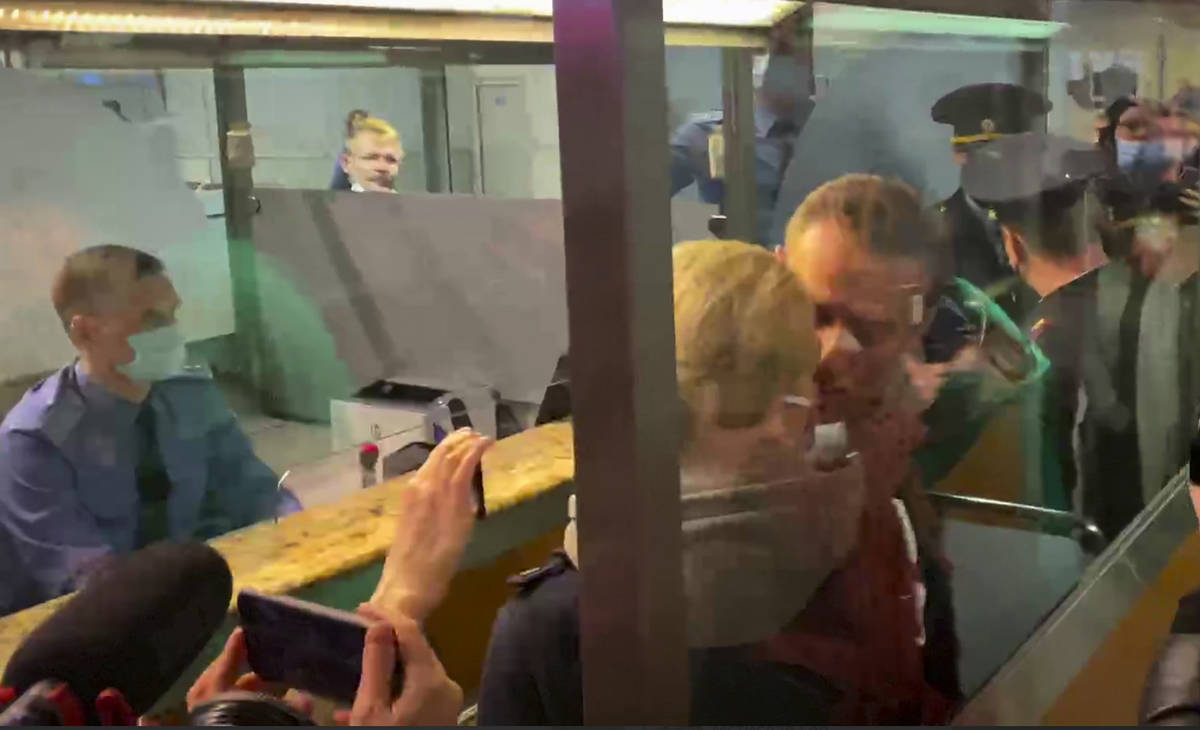 In this photo taken from video, Alexei Navalny kisses his wife Yulia as he is detained by polic ...