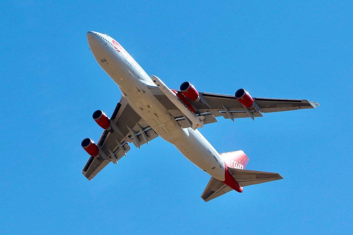 Virgin Orbit Boeing 747-400 rocket launch platform, named Cosmic Girl, takes off from Mojave Ai ...