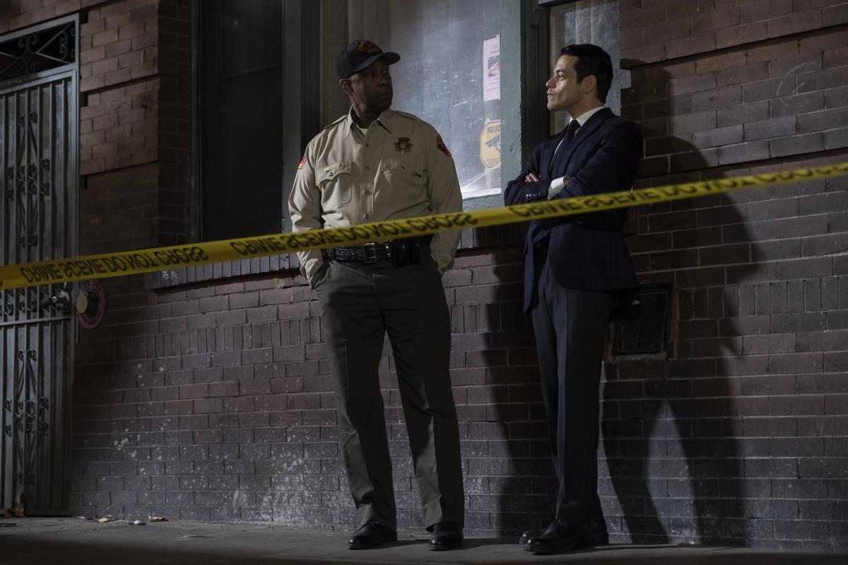 """Denzel Washington stars as Joe """"Deke"""" Deacon, left, with Rami Malek as Jim Baxter in the ne ..."""
