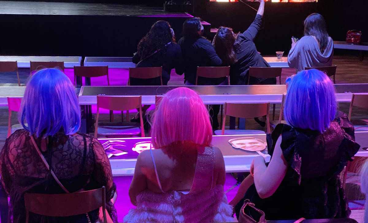 A trio of audience members sport fluorescent wigs during a return of Thunder From Down Under at ...