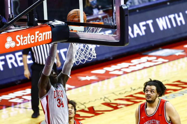 UNLV Rebels forward Cheikh Mbacke Diong (34) dunks the ball as Benedictine Mesa Redhawks' Mauri ...