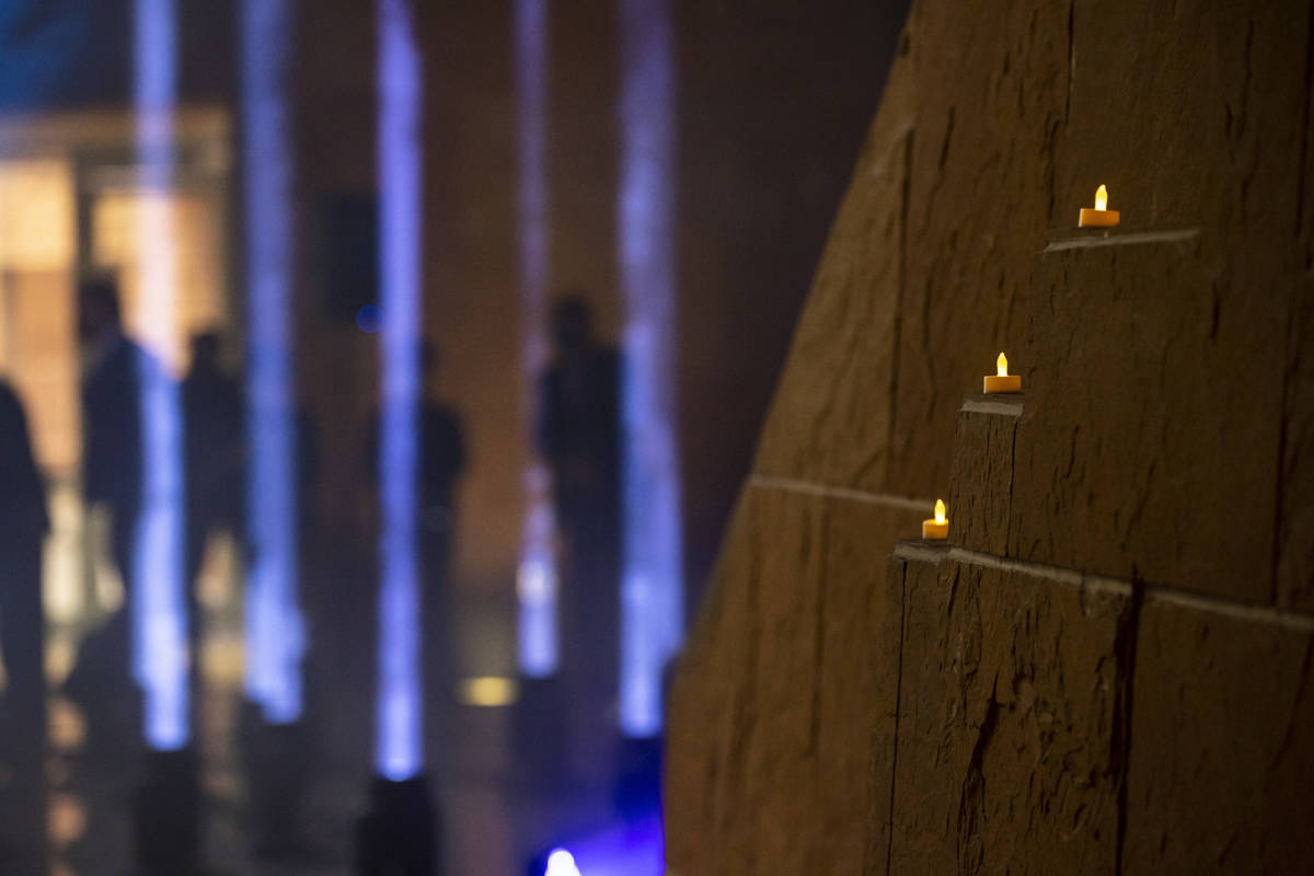 Candles are pictured as 29 lights illuminate the rotunda at the Clark County Government Center ...