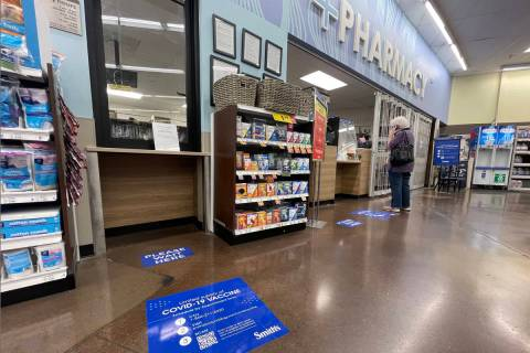 Floor stickers with COVID-19 vaccination information at Smith's at Flamingo and Sandhill ...