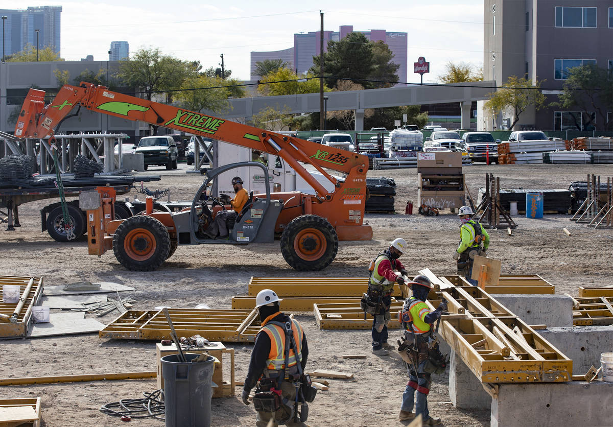 Construction workers work on the future medical education building for UNLV's School of Medic ...