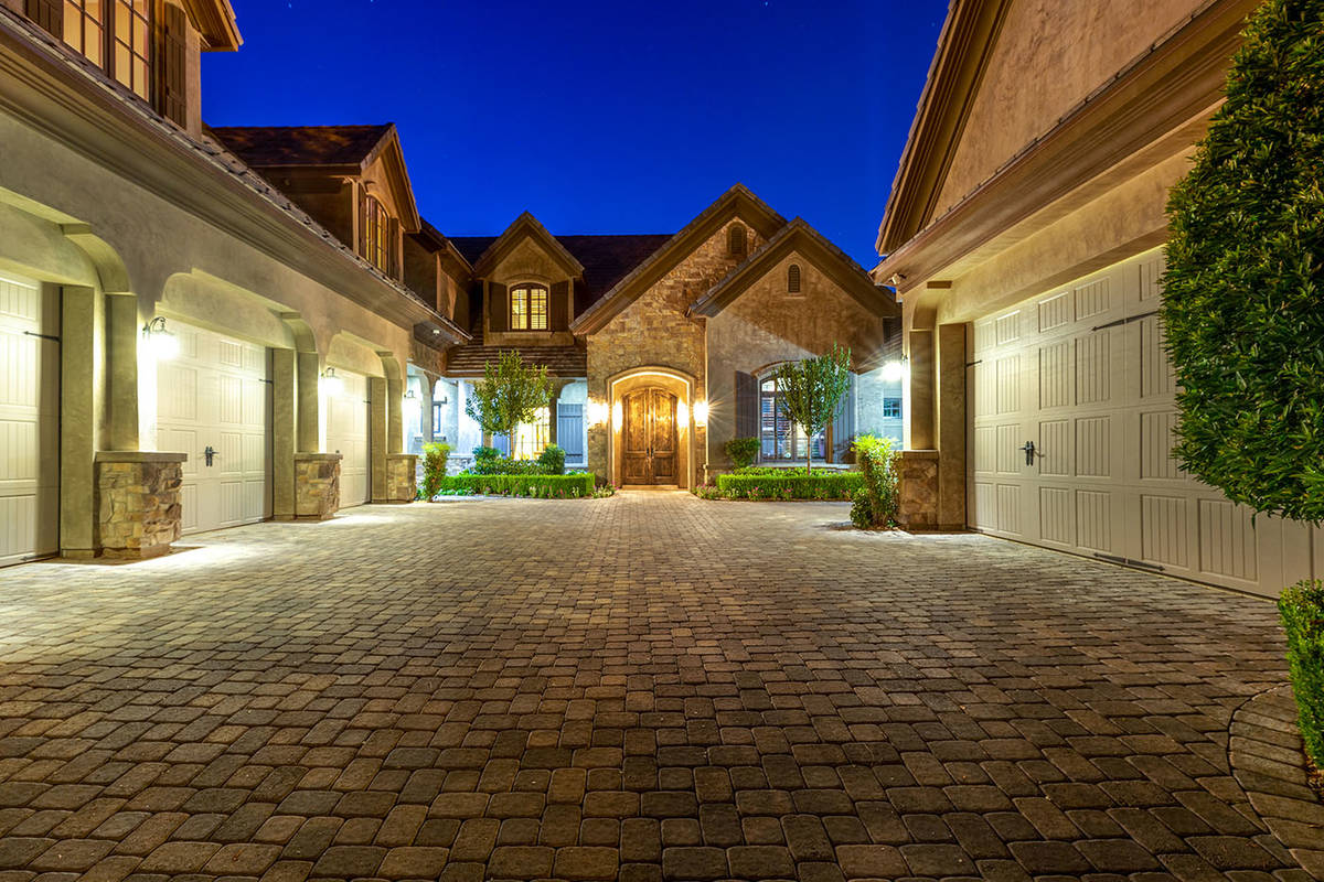 The two-story 9,2450-square-foot Southern Highlands home has six bedrooms, eight baths and a fi ...