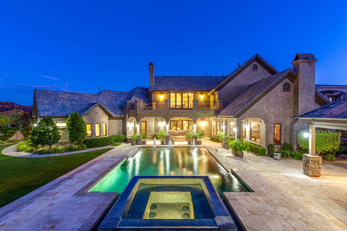 The backyard features an infinity-edge pool, spa, barbecue, multiple covered patio areas, an ou ...