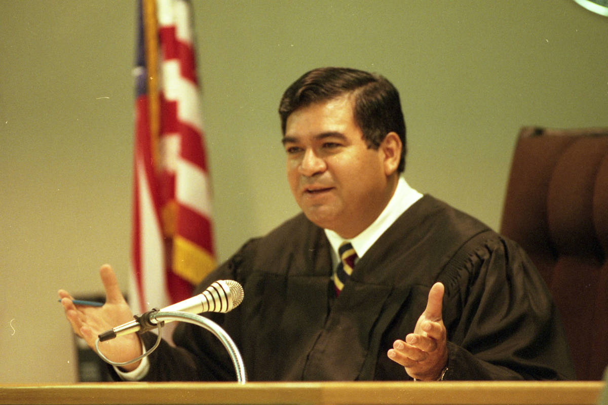 District Judge Don Chairez speaks during an arraignment in the Clark County Courthouse in Las V ...