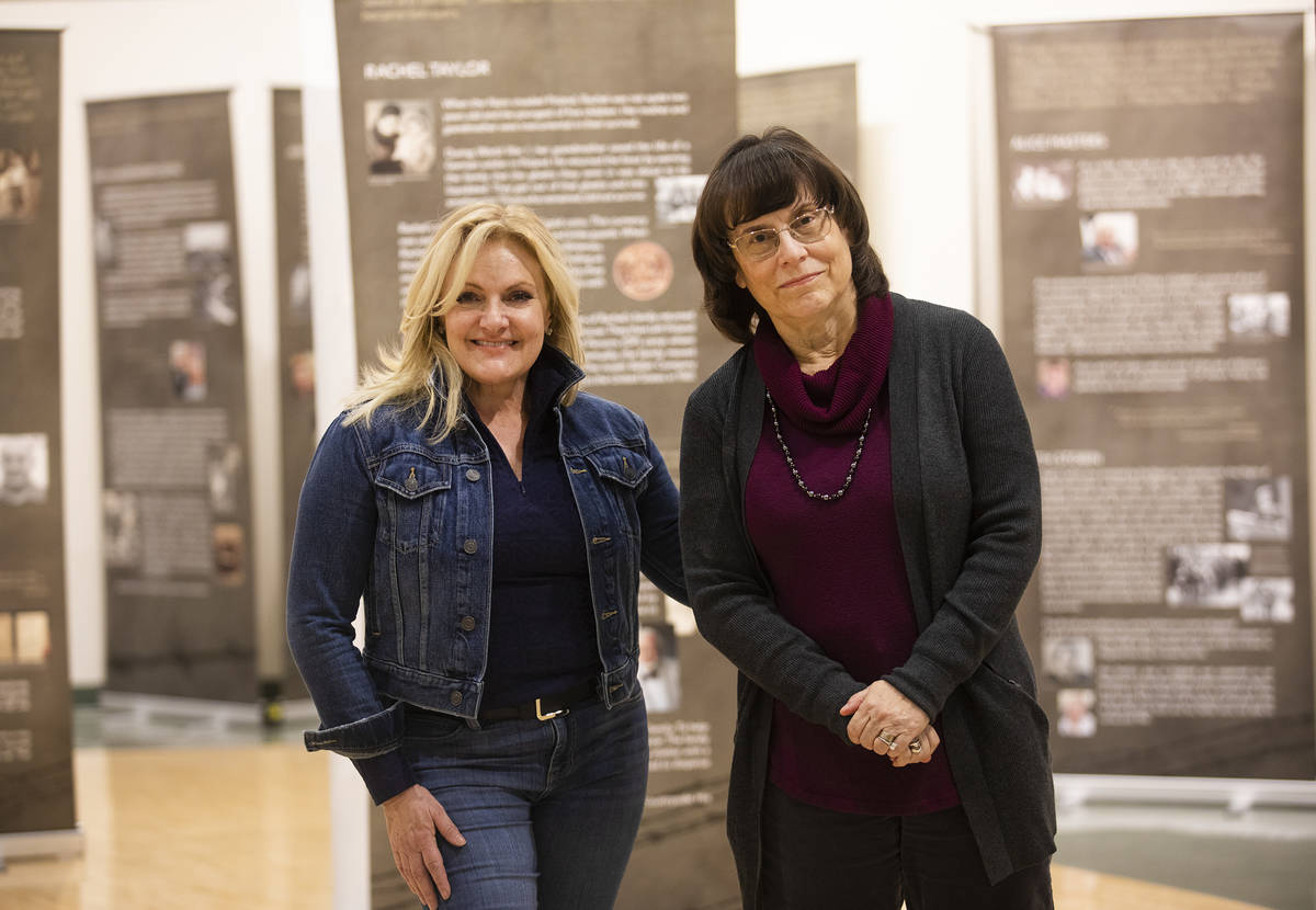 Heidi Sarno Straus, left, exhibit co-creator and chair of the Holocaust Education Task Force, a ...