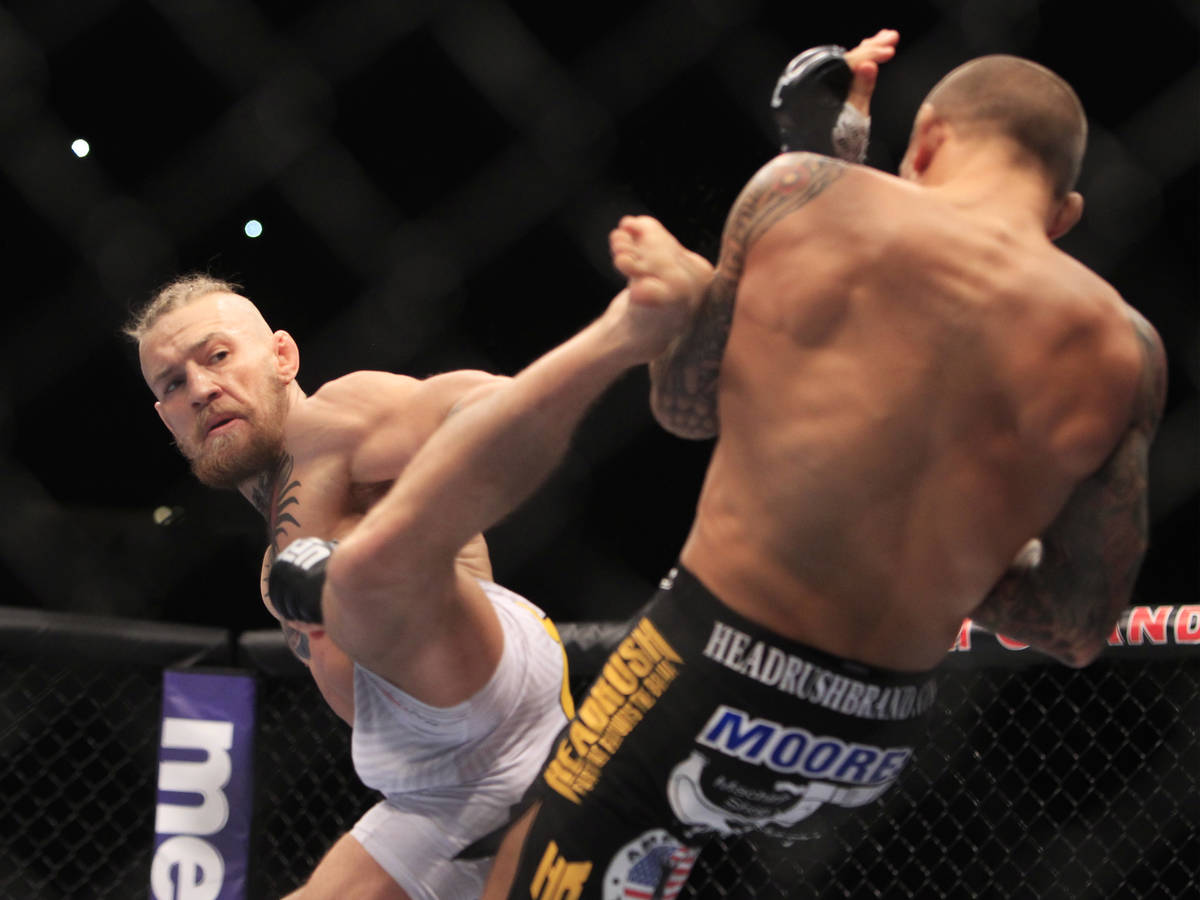Conor McGregor throws a kick at Dustin Poirier during their fight at UFC 178 Saturday, Sept. 27 ...