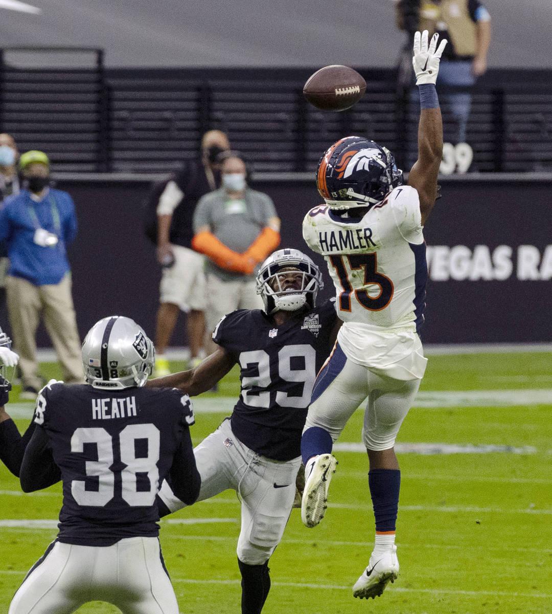 Las Vegas Raiders safety Lamarcus Joyner (29) defends as Denver Broncos wide receiver KJ Hamler ...