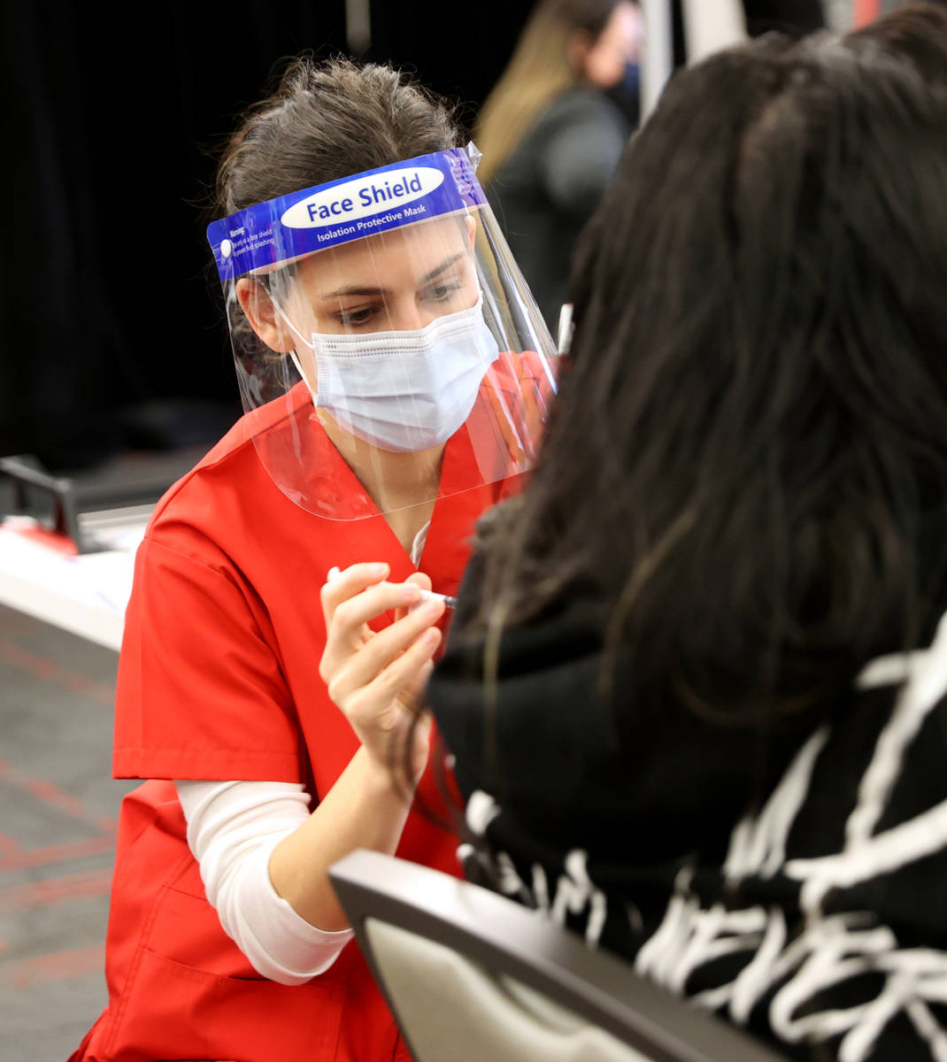 Nursing student Stephanie Soiberg gives a COVID-19 vaccine during a UNLV Medicine clinic in the ...