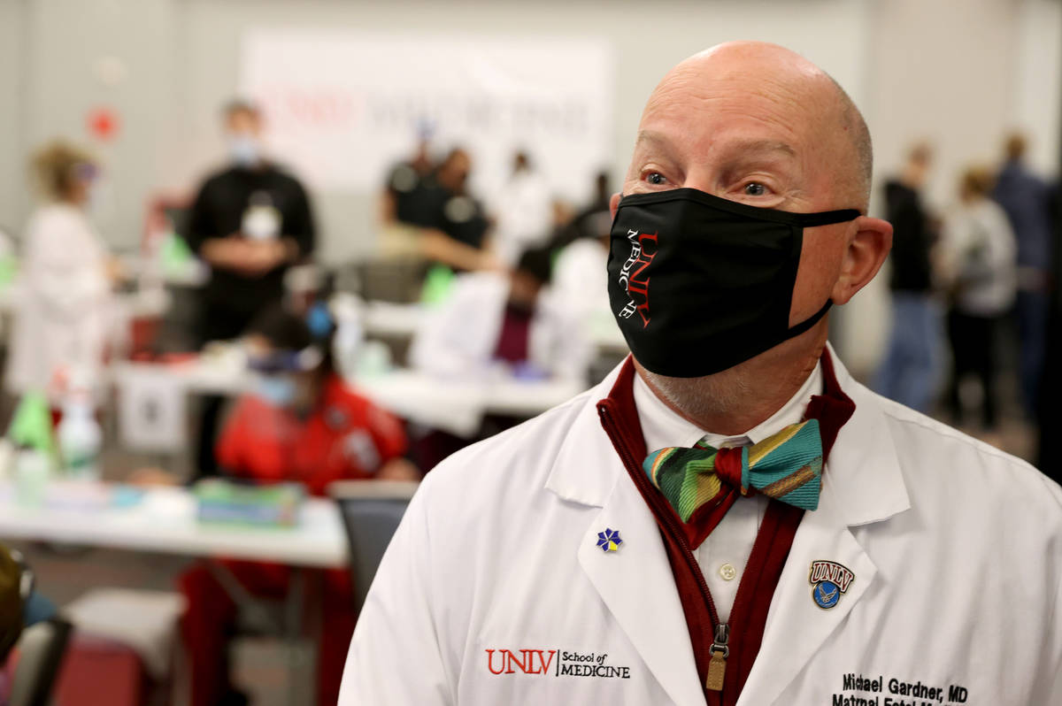 Dr. Michael Gardner, Vice Dean of Clinical Affairs at UNLV School of Medicine, talks to a repor ...