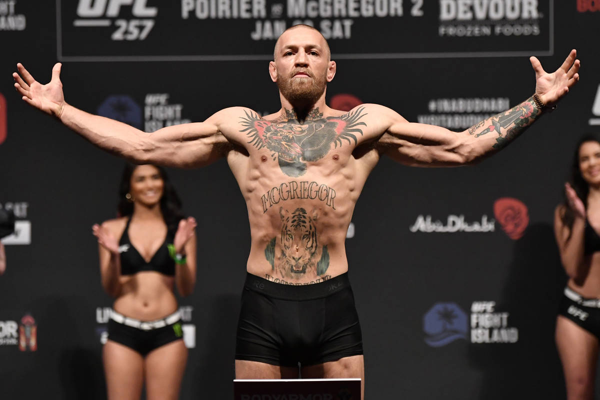 Conor McGregor of Ireland poses on the scale during the UFC 257 weigh-in at Etihad Arena on UFC ...