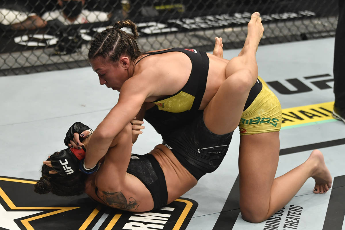 ABU DHABI, UNITED ARAB EMIRATES - JANUARY 23: (R-L) Amanda Ribas of Brazil punches Marina Rodri ...