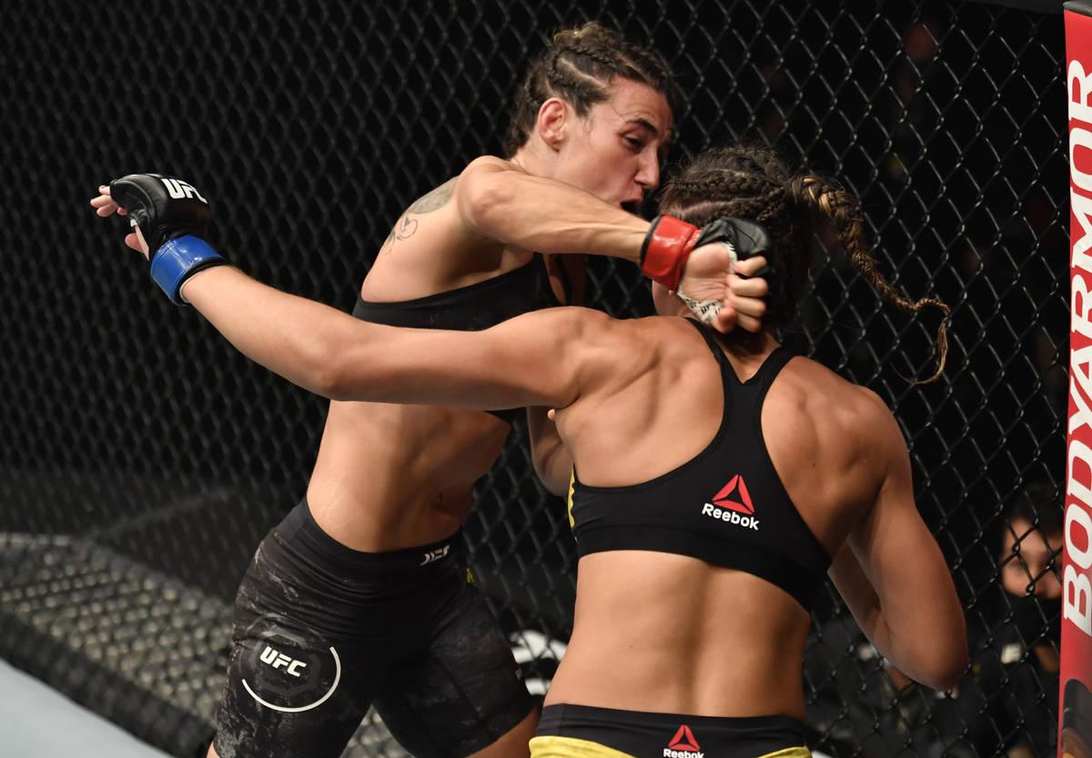 ABU DHABI, UNITED ARAB EMIRATES - JANUARY 23: (L-R) Marina Rodriguez of Brazil punches Amanda R ...