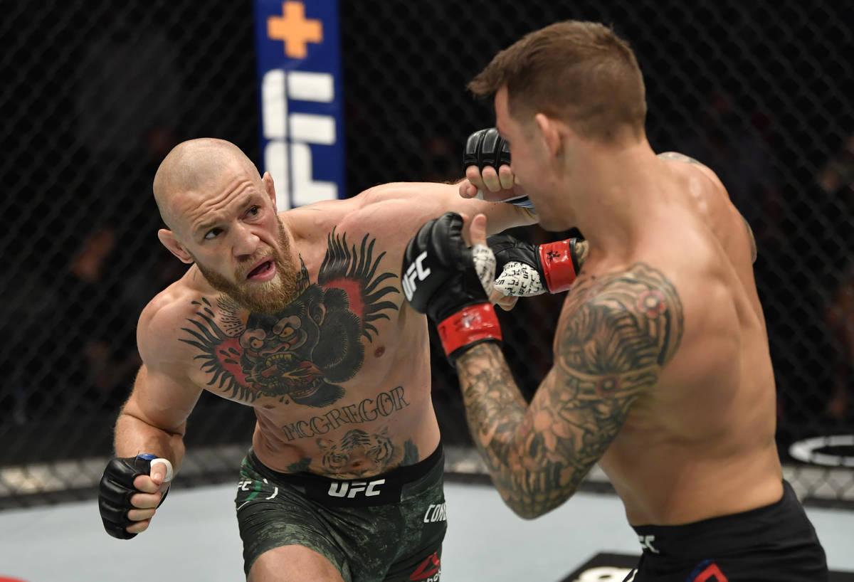 ABU DHABI, UNITED ARAB EMIRATES - JANUARY 23: (L-R) Conor McGregor of Ireland punches Dustin Po ...