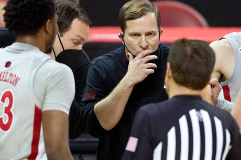 UNLV's head coach T. J. Otzelberger communicates with a referee during the second half of a bas ...