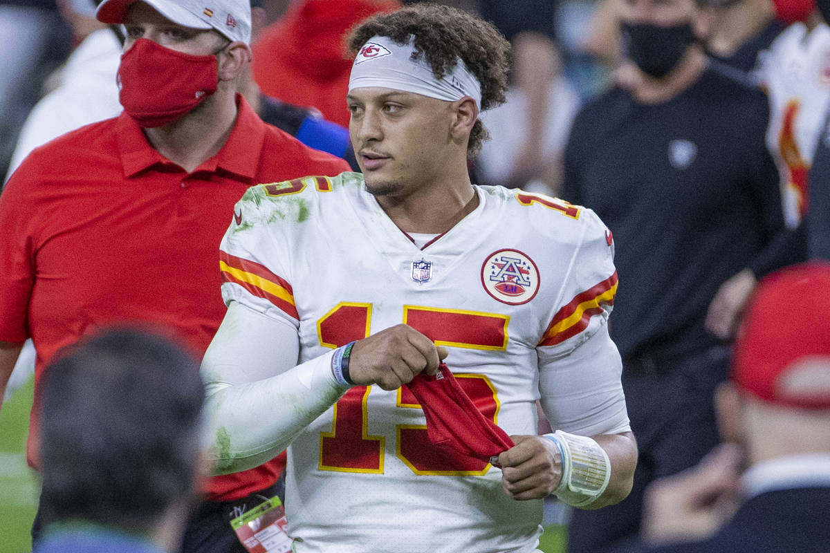Kansas City Chiefs quarterback Patrick Mahomes (15) walks off the field after defeating the Las ...