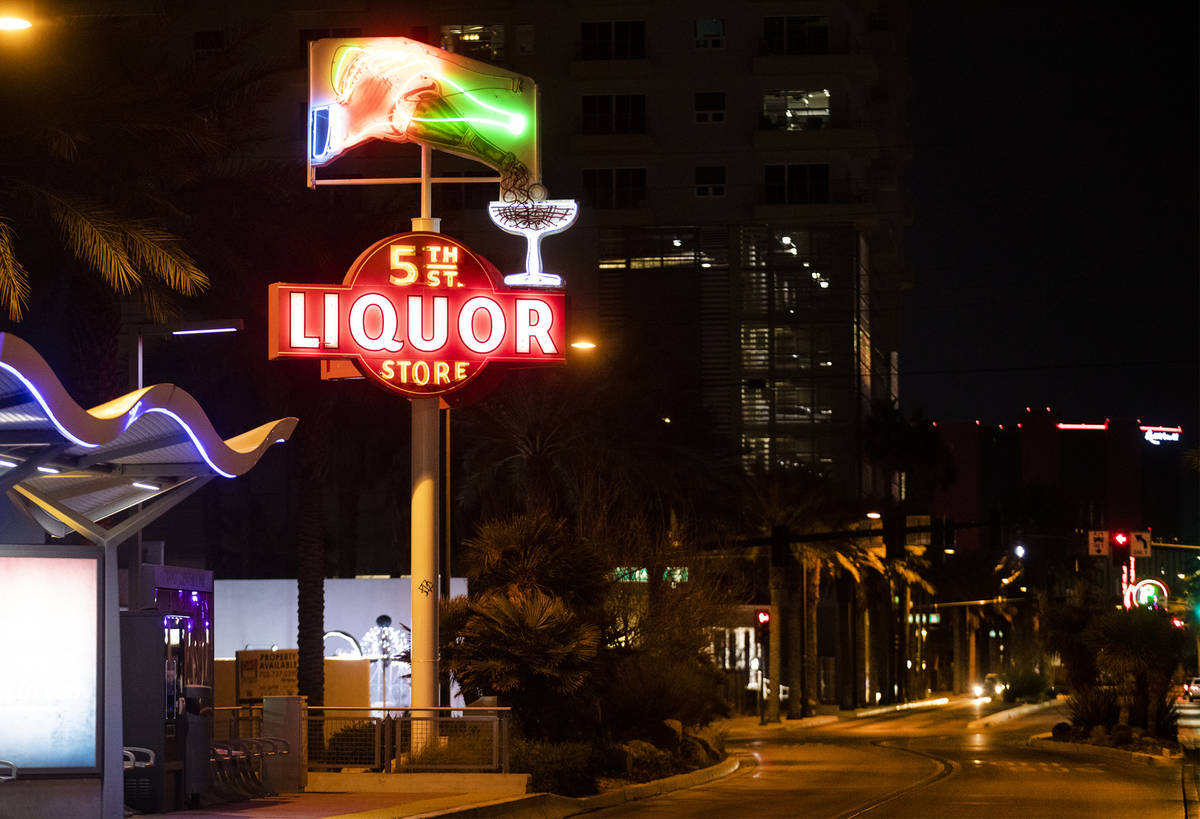 The restored neon sign for 5th Street Liquor Store on Casino Center in Downtown Las Vegas, Wedn ...