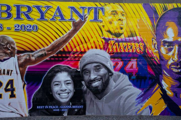 A mural of Kobe and Gianna Bryant, created by Eric Meidenbauer, outside of Candid Worldwide at ...