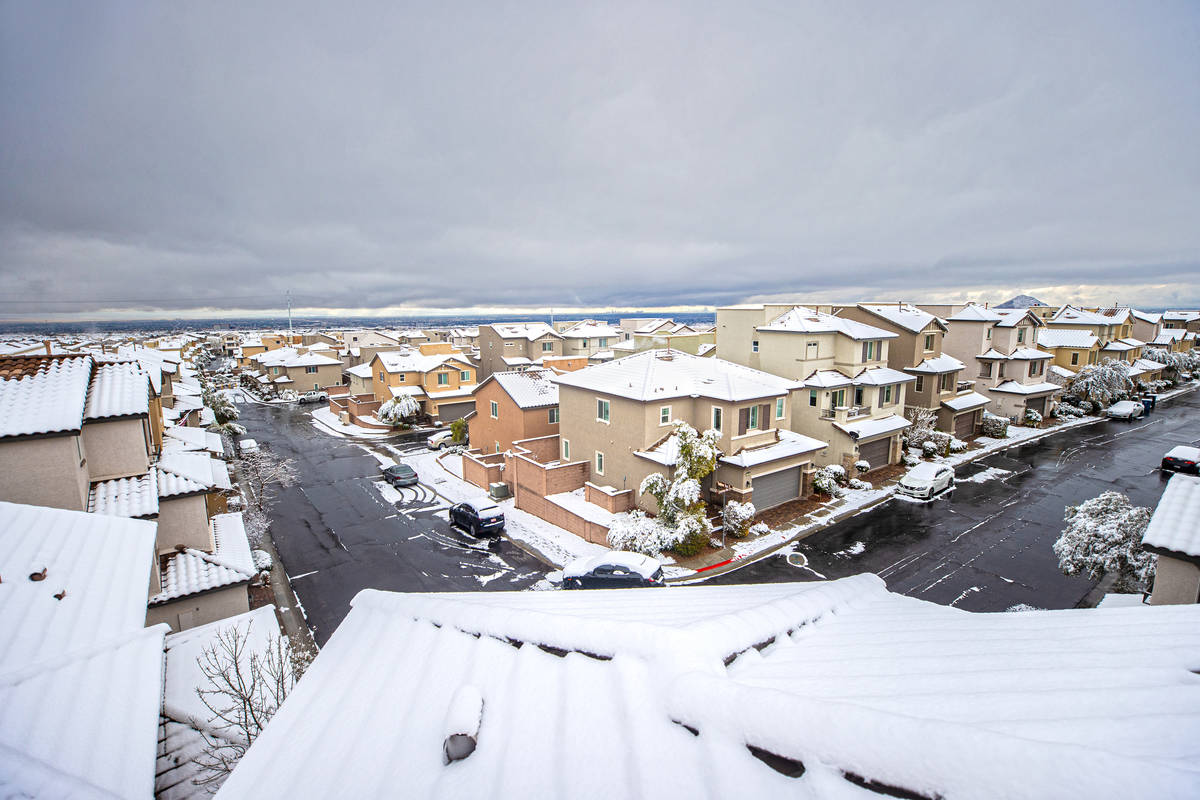 Snow covers the rooftops of homes in northwest Las Vegas on Tuesday, Jan. 26, 2021. (Benjamin H ...