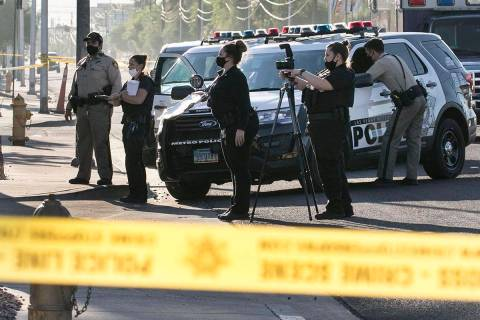 The Metropolitan Police Department investigates a shooting in the parking lot of the Kensington ...
