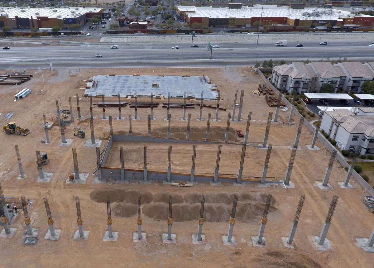Interstate 215 is seen from this aerial view of the construction site of Axiom, an office compl ...