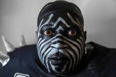 "Raiders super fan Wayne Mabry, known as ""Violator,"" in his hotel room at 4 a.m. in Dublin, Cali ..."