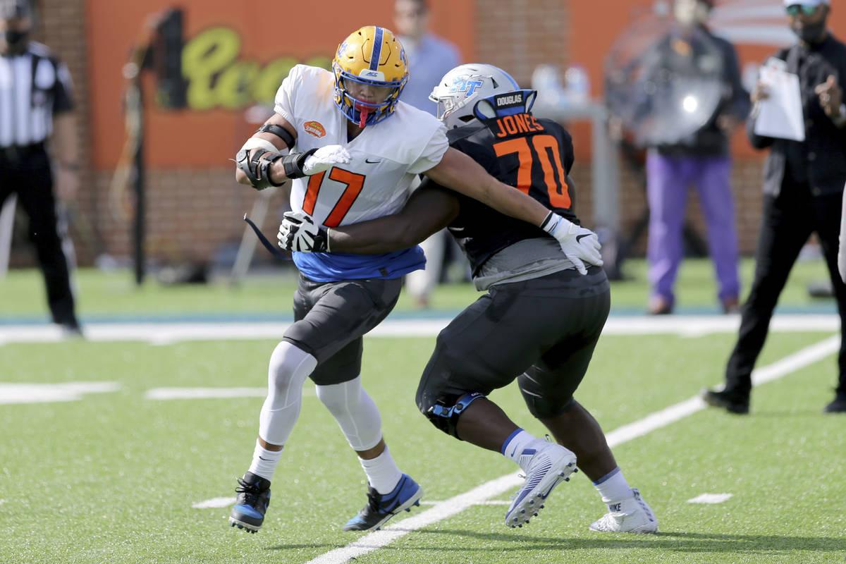 National Team defensive lineman Rashad Weaver of Pittsburgh (17) battles National Team offensiv ...
