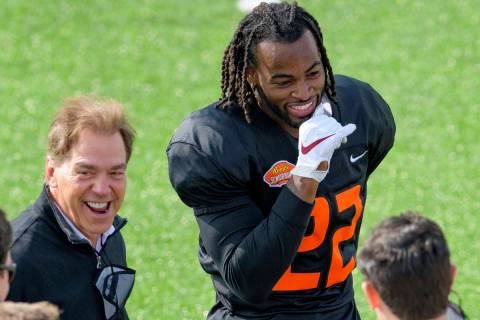 National Team running back Najee Harris of Alabama (22) laughs with Alabama head coach Nick Sab ...