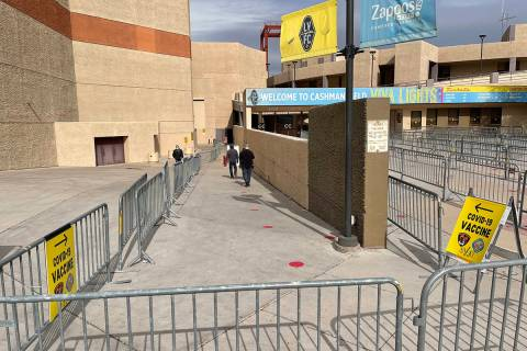 People arrive for COVID-19 vaccines at Cashman Center in Las Vegas Wednesday, Jan. 26, 2021. (K ...