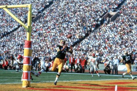 Green Bay Packers wide receiver Max McGee (85) gets set to catch the ball in the end zone for a ...