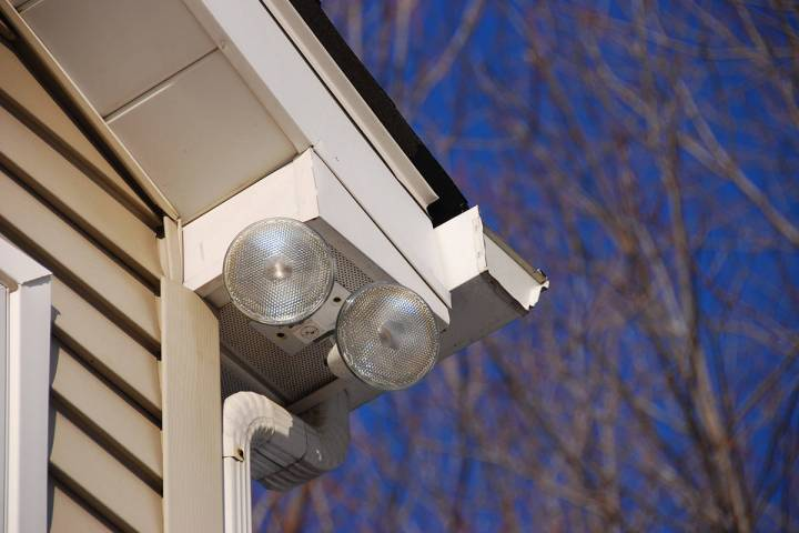 Floodlights attached to house corner to provide security and lighting to the driveway below. (G ...