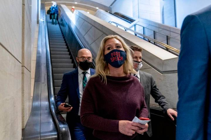 Rep. Marjorie Taylor Greene, R-Ga., goes back to her office after speaking on the floor of the ...
