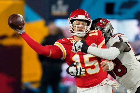 Kansas City Chiefs quarterback Patrick Mahomes passes under pressure from Tampa Bay Buccaneers ...