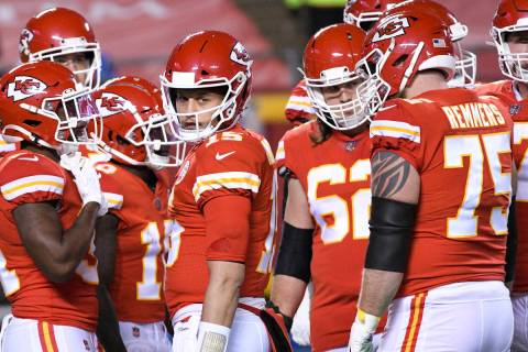 Kansas City Chiefs quarterback Patrick Mahomes looks to the sidelines during a break in play du ...