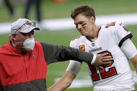 In this Jan. 17, 2021, file photo, Tampa Bay Buccaneers coach Bruce Arians, left, speaks with q ...