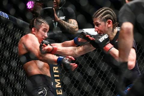 Maycee Barber, left, gets knocked to the cage by Roxanne Modafferi during their flyweight bout ...