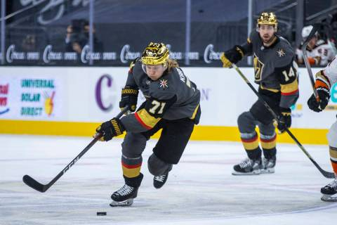 Golden Knights center William Karlsson (71) moves the puck up the ice with Anaheim Ducks defens ...