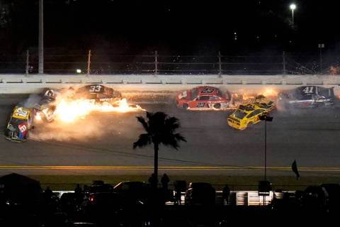 Racers crash during the last lap in the NASCAR Daytona 500 auto race at Daytona International S ...