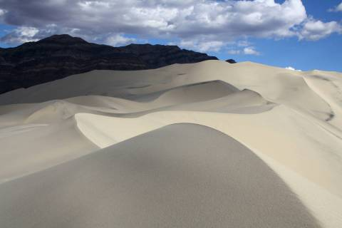 "Eureka Dunes are about three miles long and one mile wide and are known as ""singing"" or "" ..."