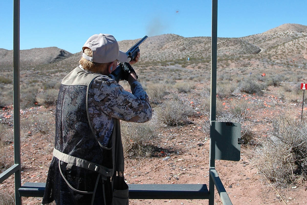 A shotgun enthusiast powders a clay target at his local shooting range. Recreational shooting, ...
