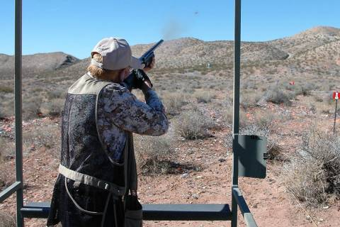 A shotgun enthusiast powders a clay target at his local shooting range. Recreational shooting, ...