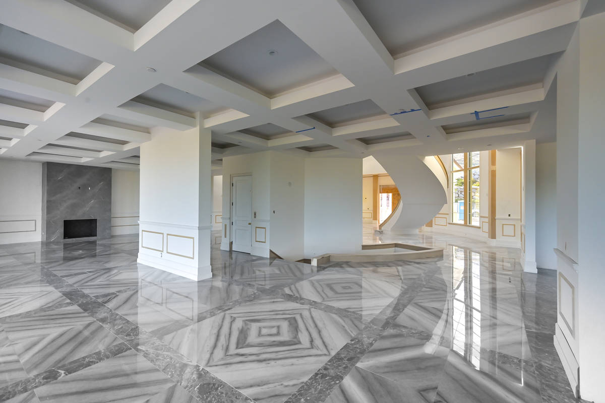 The home has a double staircase and fireplace in the center and looks dramatic when walking thr ...