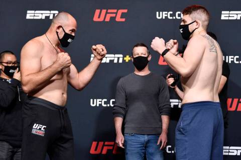 (L-R) Opponents Aleksei Oleinik of Russia and Chris Daukaus face off during the UFC weigh-in at ...