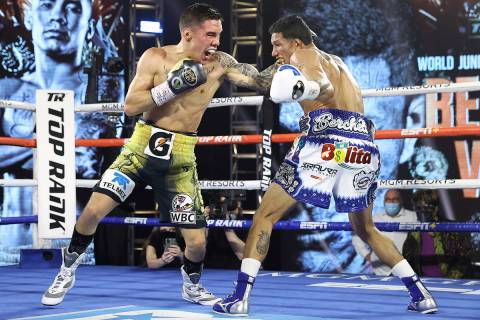 Oscar Valdez, left, and Miguel Berchelt exchange punches during their fight for the WBC super f ...